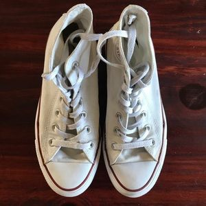 White high top chuck Taylor converse shoes